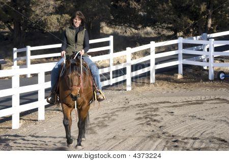 Woman Riding A Bay Horse