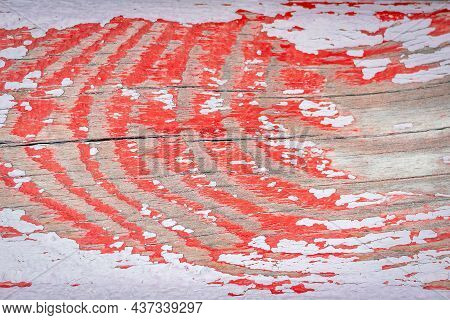 Close Up Of Texture Of Old Scratched Weathered Wooden Boards With Peeling And Worn Red And White Pai