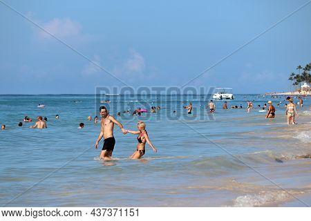Punta Cana, Dominican Republic - October 2021: People Swimming In Atlantic Ocean, Happy Couple On Fo