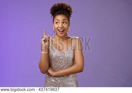 Creative Joyful Dreamy Young African-american Girl In Silver Dress Raise Index Finger Eureka Gesture