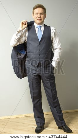 Young serious man dressed in a suit