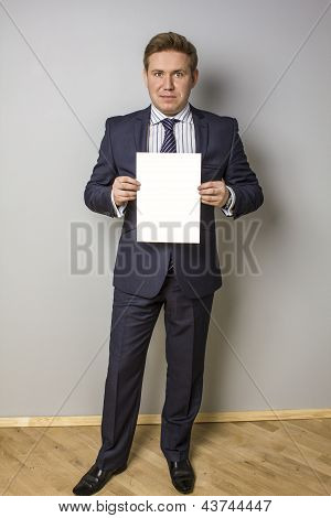 Young serious man with paper