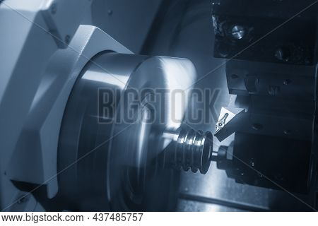 The  Cnc Lathe Machine Groove Cutting The Metal Pulley Parts. The Hi-technology Automotive Parts Man