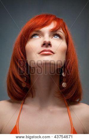 beautiful redhead girl looking up