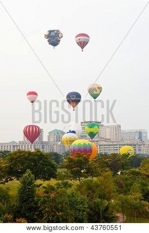 PUTRAJAYA, MALAYSIA - MARCH 2013 - Hot air balloons take off at the annual Hot Air Balloon Fiesta on