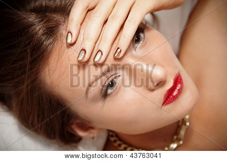 Portrait of attractive girl with beautiful metallic spiral pattern Minx nails poster