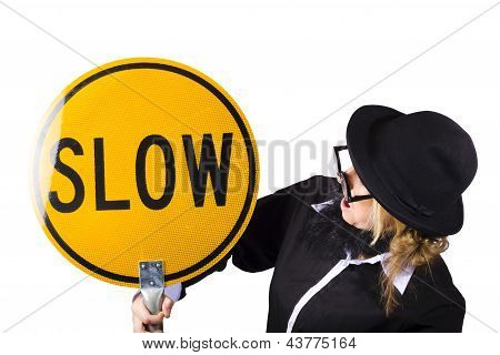 Woman In Black Holding Yellow Slow Sign