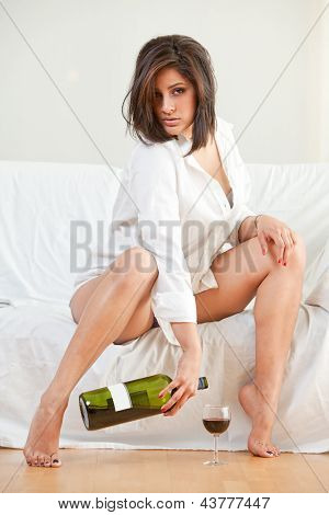 Sensual Brunette Hispanic Woman Relaxing And Lounging