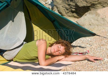 Girl Sleeping Near Of Tent