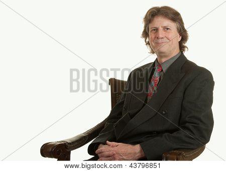 Successful man in chair
