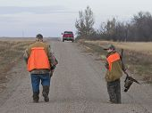 Grandpa and grandson out pheasant hunting in the fall poster