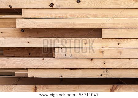 Pile of new wooden boards on a storage. Side background texture poster