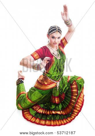 Bollywood dancer in green and orange folded dress posing as cobra poster