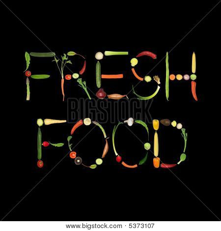 Vegetable selection spelling the words fresh food over black background. poster