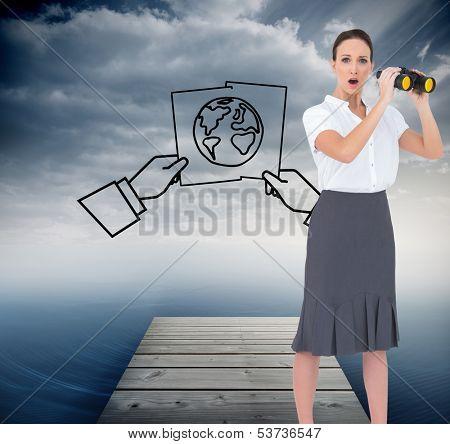 Composite image of astonished elegant businesswoman holding binoculars while posing