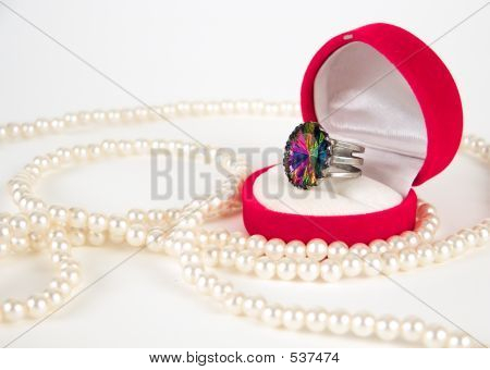 Pearls And Expensive Ring