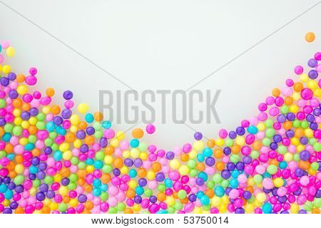 Sugar sprinkle dots, on natural white background, decoration for confectionery. High magnification macro.