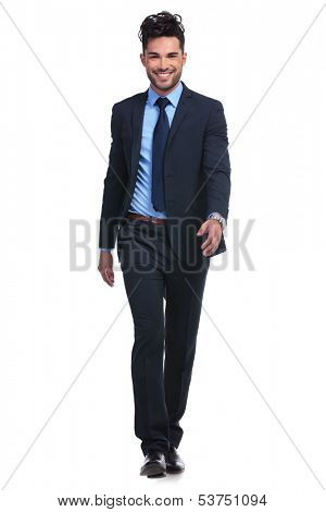 full body picture of a young smiling business man walking forward towards the camera on white background
