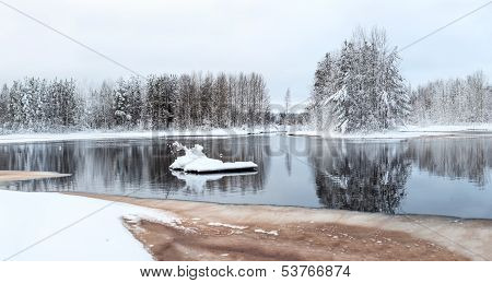Panorama Of Unfrozen Winter Lake With Snow-covered Trees