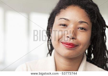 Portrait of smiling businesswoman with dreadlocks
