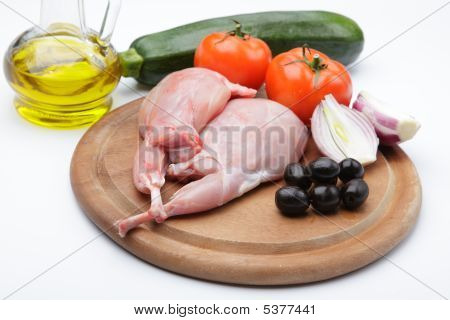 Raw Rabbit Legs With Vegetables