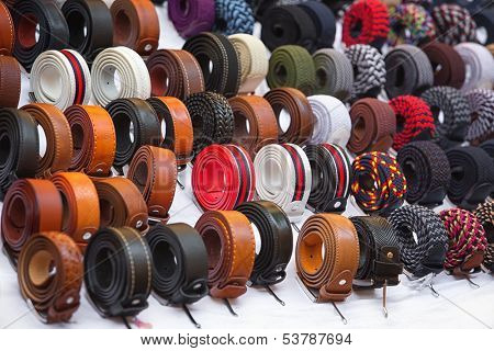 Many kinds of belts on white baskground