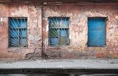 Old abandoned building wall texture with blue windows poster