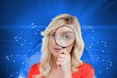 Composite image of fair-haired woman looking through a magnifying glass  poster