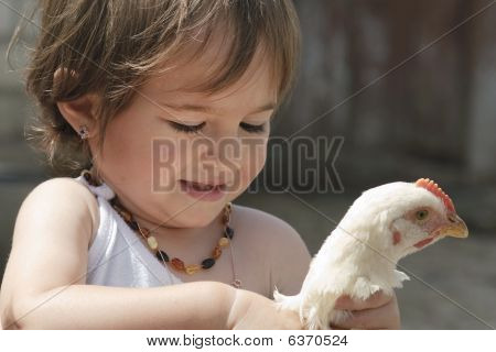 Little girl and chicken