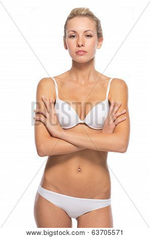 Portrait Of Confident Young Woman In Lingerie