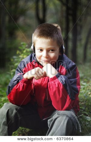 Boy In Dark Forest Listens Music