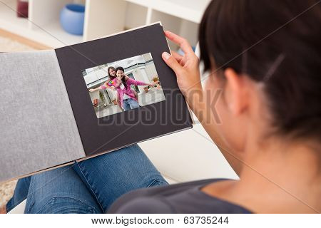 Woman With Photo Album