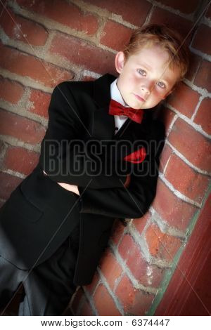 handsome child in tuxedo