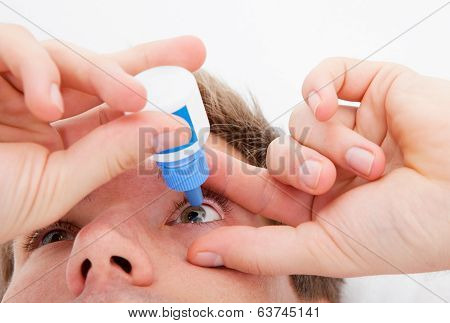 Man Pouring Drops In His Eyes