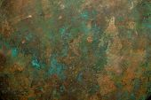 Background image of scratched antique copper vessel surface texture. poster