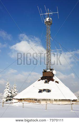 Radio Antenna Communication Tower At Winter Snow