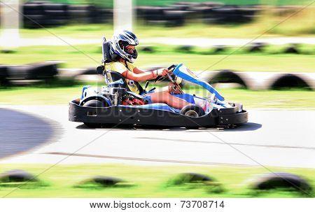People Having Fun On A Go Cart. Summer Season