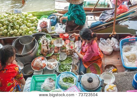 A Woman Makes Thai Food At Damnoen Saduak Floating Market