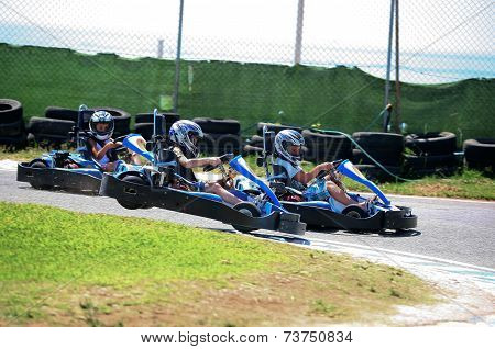 Boys Having Fun On A Go Cart. Out Of Track Jump