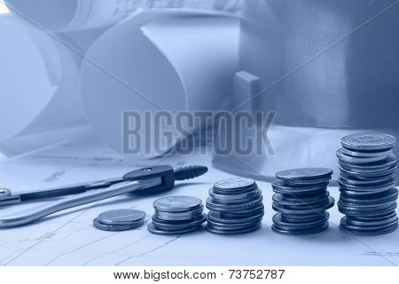 Five coin piles, dividers and rolled drafts