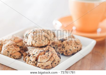 Closeup Cereal Cookies On White Plate With Coffee Cup