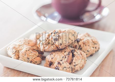 Closeup Mixed Nut Cookies With Violet Coffee Cup