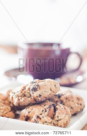 Closeup Cereal Cookies With Violet Coffee Cup