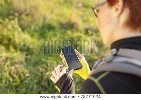 Female Holding Digital Compass In The Nature