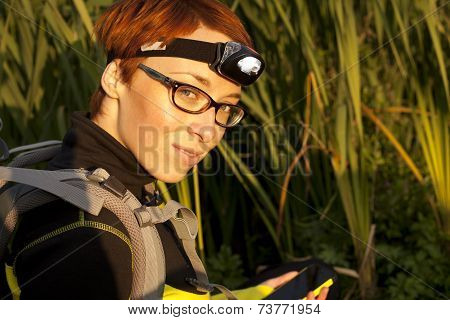 Young Woman With Headlamp And Digital Compas geocaching
