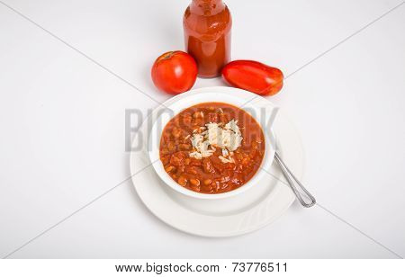 Chili And Rice In White Bowl With Fresh Tomatoes
