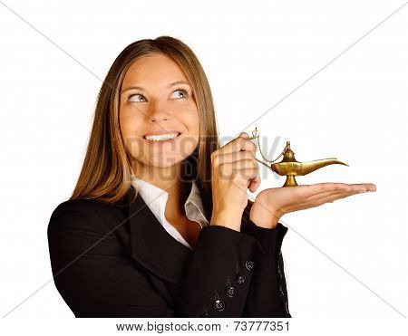 Business woman holding a lamp of Aladdin.