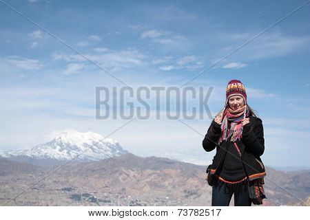 Youn woman traveler with panorama La Paz