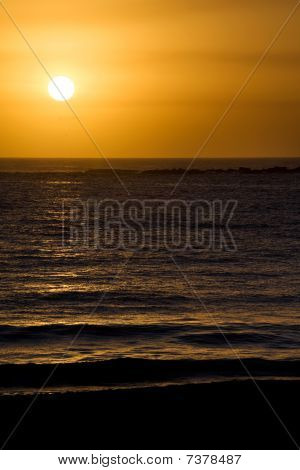 Glorious Completed Sunrise Over Ocean And Beach.  Clear Skies.