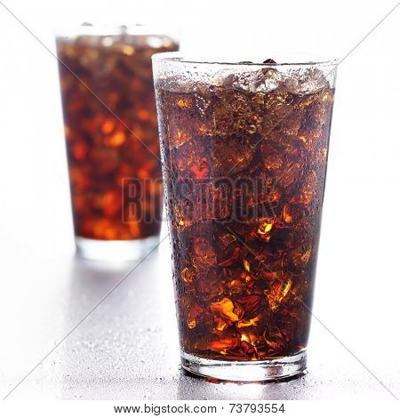 two glasses of cola on white background.